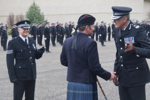 Chief Constable Phil Gormley enjoys a few words with Drum Major Roland Stuart